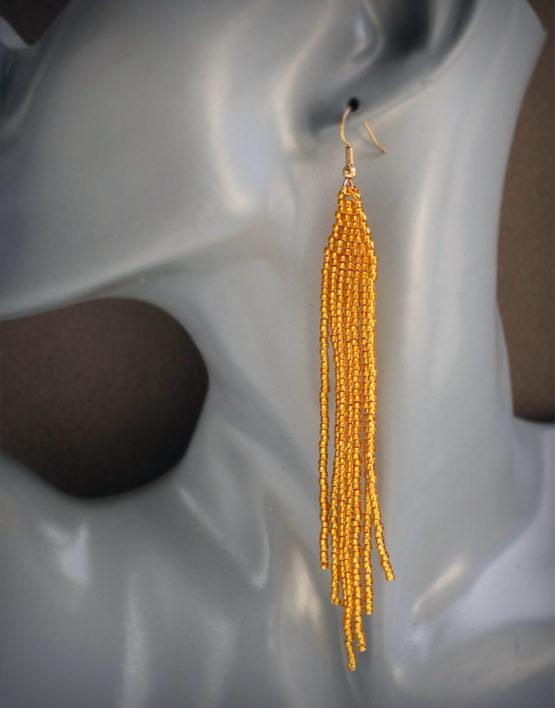 купить длинные золотистые висячие сережки из бисера